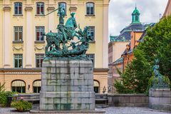 Saint George and the Dragon sculpture  in Old Town Gamla Stan St. Saint George and the Dragon sculpture on Kopmantorget Merchant Square, bronze copy by Meyer Stock Photography