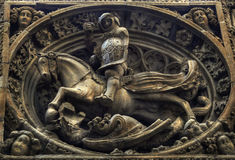 Saint George and the dragoon. Bas-relief of Saint George and the dragon in the Gothic quarter of Barcelona stock photos