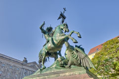 Saint George Fighting the Dragon Statue at Berlin, Germany. Saint George Fighting the Dragon Statue located on Nikolai Quarter of Berlin, Germany Royalty Free Stock Image