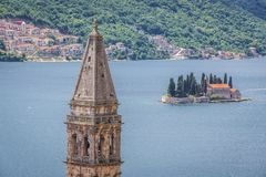 Saint George islet in Montenegro. St Nicholas church tower in Perast, old town on the Kotor Bay coast, Montenegro, Sveti Dorde isle on background stock photography