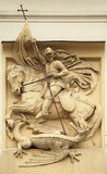 Saint George killing Dragon. Stucco decoration on Art Nouveau bu Royalty Free Stock Photos