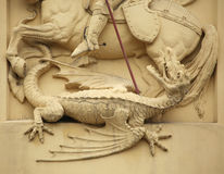 Saint George killing Dragon. Stucco decoration Royalty Free Stock Photos