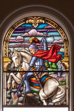 Saint George in Santo Angelo Cathedral. Saint George killing the dragon with a spear in a glass window of Santo Angelo Cathedral, Rio Grande do Sul, Brazil Royalty Free Stock Photography