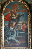 Saint George slaying the dragon Stock Images