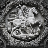 Saint George the Victorious spearing a serpent Royalty Free Stock Photography