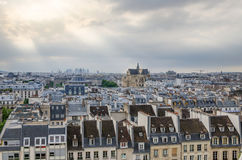 Saint-Germain l'Auxerrois church among roofs of paris Stock Image