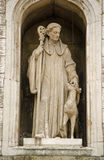 Saint Giles Statue, London. Statue of Saint Giles with a hind (deer) on the exterior of St Giles Cripplegate church in the Barbican, City of London.  Historic Stock Image