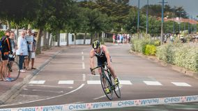 Leading cyclist in a turn on the French Championship final triathlon stock image