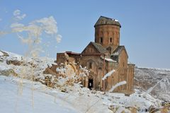 Saint Gregory church in winter. Ruins of famous  Saint Gregory Tigran Honents church against winter landscape background. Ani is a ruined medieval Armenian city Stock Photos