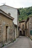 Saint-Guilhem. LE-DESERT, FRANCE - CIRCA JULY 2015 Main street of village royalty free stock images