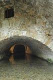 Saint-Guilhem-le-Desert (France). Saint-Guilhem-le-Desert (Herault, Languedoc-Roussillon, France): canal under a stone arch royalty free stock photo