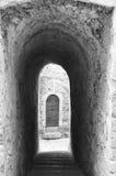 Saint-Guilhem-le-Desert (France). Saint-Guilhem-le-Desert (Herault, Languedoc-Roussillon, France): typical buildings of the medieval village. Black and white royalty free stock images