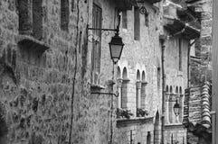 Saint-Guilhem-le-Desert (France). Saint-Guilhem-le-Desert (Herault, Languedoc-Roussillon, France): typical buildings of the medieval village. Black and white royalty free stock photography