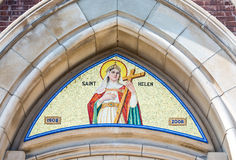 Saint Helen image in arch above Catholic Church entrance in Toronto. The arch of Saint Helen Catholic Church depicting Saint Helen holding the cross. St. Helen's Royalty Free Stock Images