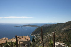 Saint-Hospice gulf seen from Èze Village, France. Èze is a commune in the Alpes-Maritimes department in southeastern France. The commune is located on the Stock Photography