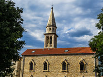 Saint Ivan Church, Budva. View of Saint Ivan Church shining in the sun with clouds in the background royalty free stock photography