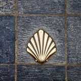 Saint James way shell golden metal on streets Royalty Free Stock Photo