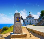 Saint James Way sign and lighthouse of Finisterre. End of Saint James Way sign and lighthouse of Finisterre in Galicia Spain photomount royalty free stock images