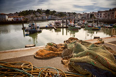 Saint Jean de Luz harbour in France. Trawlers and fishing nets in Saint Jean de Luz harbor, Pays Basque, France Stock Photography