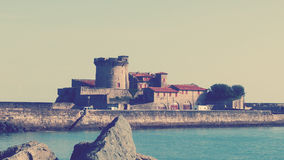Saint Jean de Luz Old Port Sokoa. Old Tower building with boats at port for aquatic sports Royalty Free Stock Photo