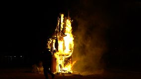 Saint Jean festival in french village. Flaming sculpture of horse. stock video