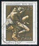 Saint John the Baptist by Caravaggio. ITALY - CIRCA 1973: stamp printed by Italy, shows Saint John the Baptist by Caravaggio, circa 1973 Royalty Free Stock Photo