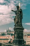 Saint John the Baptist on Charles Bridge in Prague stock photo
