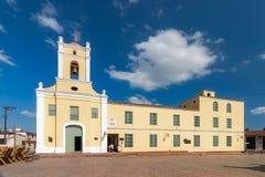 Saint John of God Church (Iglesia de San Juan de Dios). CAMAGUEY, CUBA -  MAY 2: Saint John of God Church (Iglesia de San Juan de Dios) and plaza shown on 2 May Royalty Free Stock Images
