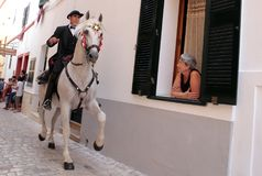 Saint john horse festivity wide. A pure brood horse is ridden on the village streets during local Saint John festivities in Ciutadella in the island of Minorca Stock Photos