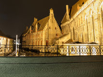 Saint John Hospital and water canal in Bruges by Royalty Free Stock Image