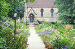 Saint John`s Chapel - Racine, Wisconsin. A beautiful flower garden with a walking path leading up to Saint John`s Chapel in Racine, Wisconsin royalty free stock photos
