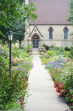 Saint John`s Chapel - Racine, Wisconsin. A beautiful flower garden with a walking path leading up to Saint John`s Chapel in Racine, Wisconsin stock images