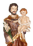 Saint Joseph and Baby Jesus. Wooden religious figure of Saint Joseph and baby Jesus. On white background Royalty Free Stock Images
