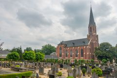 Saint Joseph Church in Vasse, Twente, the Netherlands. Taken from the cemetery stock images