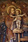 Saint Joseph holding baby Jesus Royalty Free Stock Photos