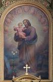 Saint Joseph holding child Jesus Stock Photography