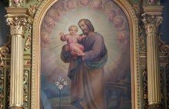 Saint Joseph holding child Jesus royalty free stock photography