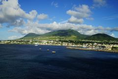 Saint Kitts Island landscape -  view from water on a brignt sunny day with some white clouds.  Royalty Free Stock Image