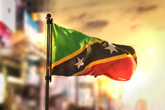 Saint Kitts and Nevis Flag Against City Blurred Background At Su Royalty Free Stock Images