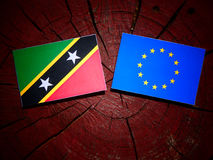 Saint Kitts and Nevis flag with EU flag on a tree stump isolated Royalty Free Stock Images