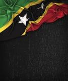 Saint Kitts and Nevis Flag Vintage on a Grunge Black Chalkboard Stock Image