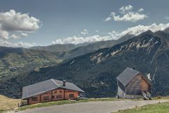 Typical mountain log cabins on the height of the mountains stock images