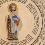 Saint Lawrence in the middle of the clock in Lund Cathedral Stock Photography