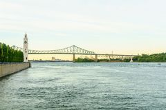 Saint Lawrence River, clock tower, and Jacques Cartier Bridge, Montreal stock images