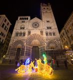 Saint Lawrence San Lorenzo Cathedral in Genoa by night with Christmas nativity scene stock photos