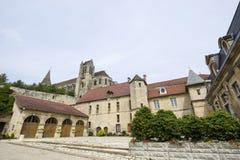 Saint-Leu - Monuments. Saint-Leu (Oise, Picardie, France) - Ancient buildings: townhall and gothic church Stock Photography