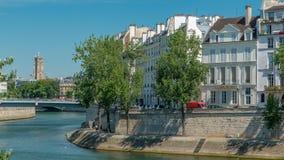 Saint-Louis bridge timelapse with houses on Orleans embankment. Paris, France. Saint-Louis bridge timelapse with houses on Orleans embankment. Two islands on stock video