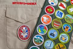 Eagle patch and merit badge sash on boy scout uniform Stock Photos