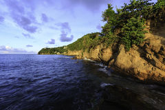 Saint Lucia Coastline at Sunset. The rocky coastline of the Northern Cap District of the Caribbean island of Saint Lucia Stock Images