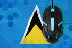 Saint Lucia flag and computer mouse. Concept of country representing e-sports team. Saint Lucia flag and modern backlit computer mouse. Concept of country royalty free stock images